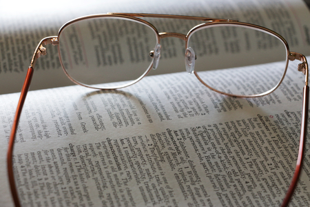 english dictionary: Glasses on an English dictionary