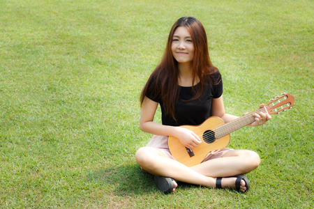 Girl playing guitar photo