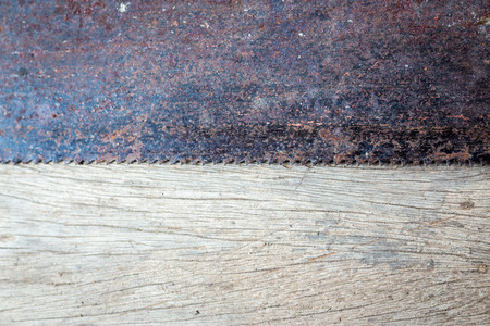 woodcraft: Rusty metallic saw on an old wood plank concept art