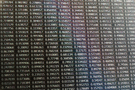 summation: Random data as numbers captured from a laptop screen with inverted color effect applied Stock Photo