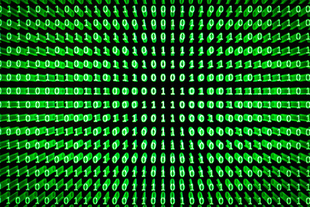 A set of random binaries captured from an LCD screen created with a spreadsheet program with glowing green letters on a black background with zoom burst technique applied Stock Photo