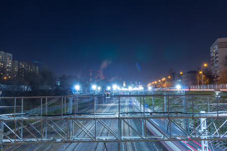 Railway metropolis with a developed infrastructure and night lighting. Evening time.