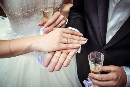 Hands newlywed with gold rings on his right hand. Wedding.