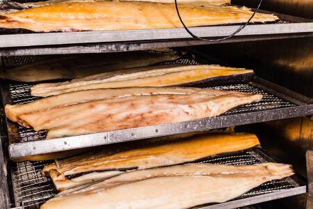 Hot smoked fish. Fish production in progress