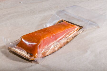 Red fish in a sealed vacuum plastic bag. Finished product