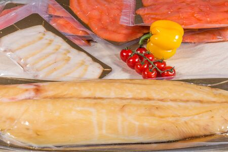 White fish in a sealed vacuum plastic bag. Finished product Stock Photo