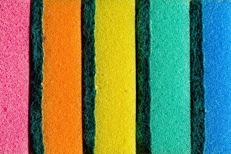 Multi-colored sponges in a row. Microfiber material. Dish washing. Stock Photo