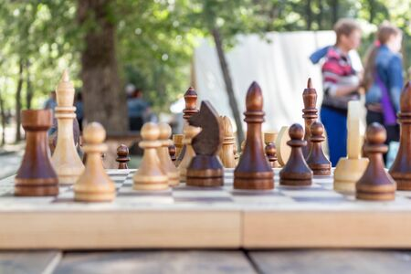 Chess is placed on the board. The game is on the street Stock Photo