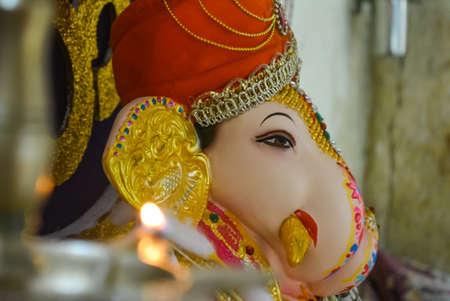Dagdusheth ganpati small idol. Pooja of a small ganpati idol. View from diya towards ganpati idol.