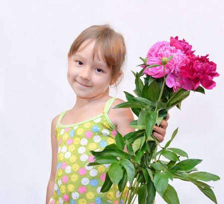 The Child keeps the flowerses, on white background. The Photo. photo