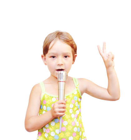 warmly: The Child and microphone, on white background.   Stock Photo