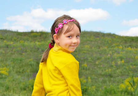The Child on background of the nature, blue sky. photo