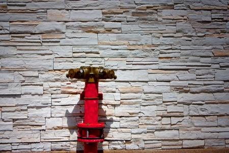 Hydrantand shadow front wall photo