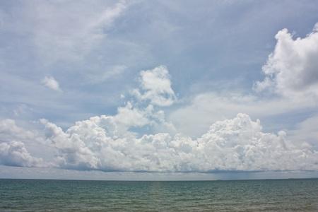 Rainy cloud on sea photo