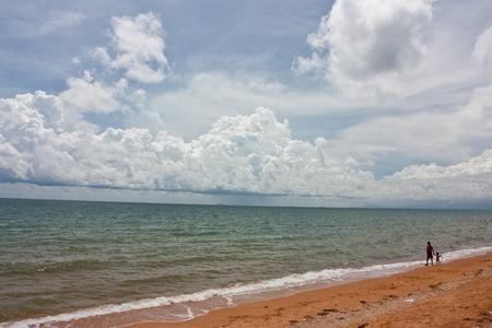 Rainy cloud on sea beach photo