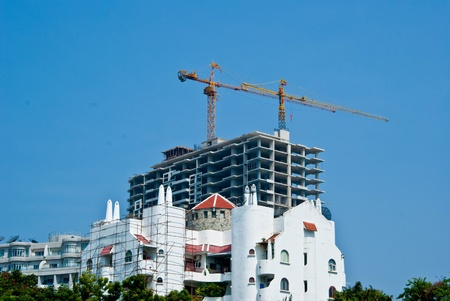 Tower crane on top of building photo