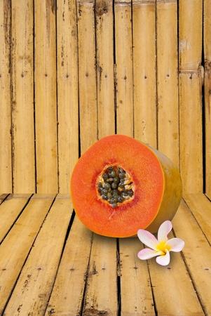 leelawadee: Papaya matured and leelawadee flower on bamboo