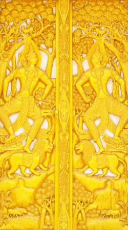 Thai pattern with gold Buddha statue on door photo