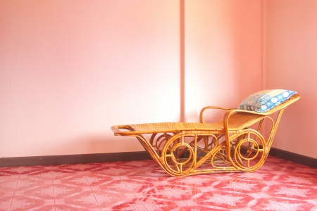 Rattan bed at cornner Stock Photo - 13688306