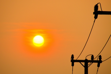 Sun set and electric pole             photo