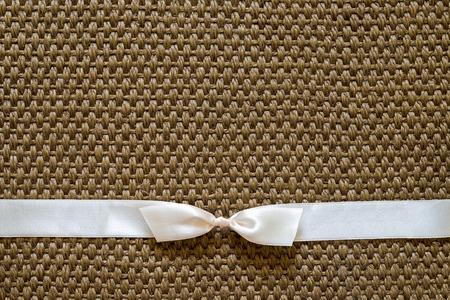 sisal: satin bow on sisal background