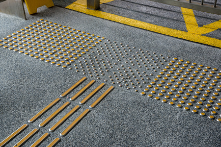 truncated: metal tactile paving for blind people in big city