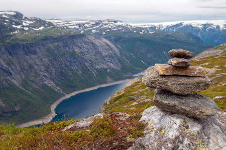 beautyful: stack of rocks stones with fjord background in the mountains of Norway Stock Photo