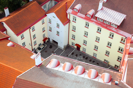 garth: top view of the yard and the house with red roofs