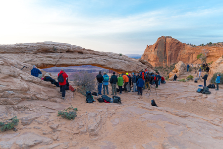 UTAH, USA - APRIL 25, 2014: people are waiting for a sunrise at Mesa Arch in Canyonlands National Park