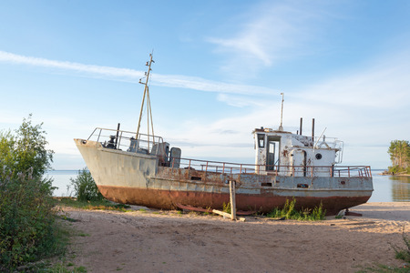 old ship: rusty old ship on the shore Stock Photo