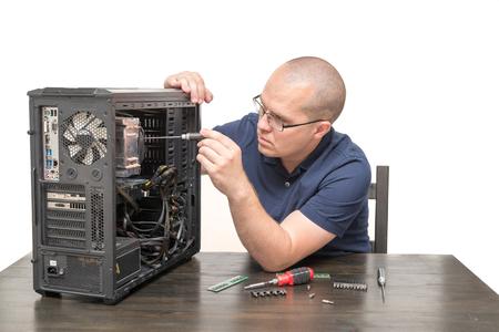 dismantle: Computer Technician repairing computer system