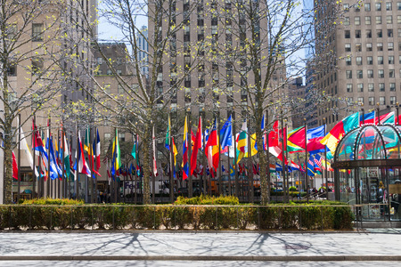 NEW YORK, USA - MAY 5, 2014: flags of different country near the Rockefeller Center in spring time, New York, USA