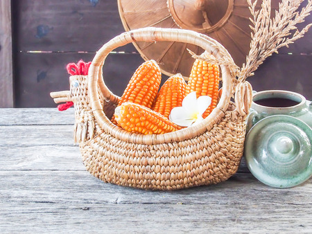 corn in basket, on wooden table photo