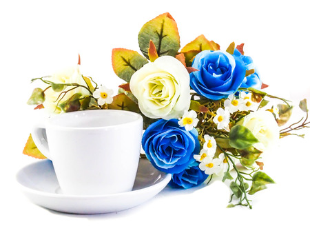 a cup with blue flowers isolated on a white background  photo