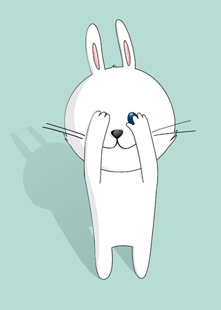 timid: Little white bunny peeking through hand with one eye