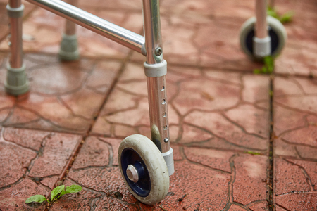 Wheel walker for adults. Close-up. Red road tile.