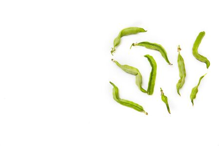 Ugly homegrown pea on a white background with copy space