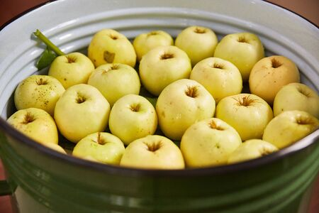 soaked apples in a large iron pot. fermented canned food concept