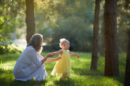 Mother and daughter walk in the Sunny summer forest Reklamní fotografie