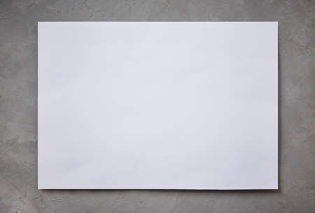 paper on a concrete background, stationery branding mockup template to place your design.