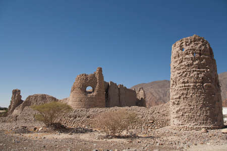 Stone walls of a collapsed city in Oman, an ancient city, ruins, remnants of civilization, the middle East.