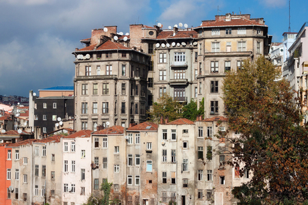 View of old houses and tiled roofs of Istanbul in the Beyoglu district. Next to the famous Taksim Square. Stock Photo