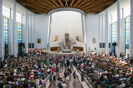 christian youth: POLAND, KRAKOW - MAY 28, 2016: Sanctuary in Lagiewniki. Basilica of the Divine Mercy. Millions of pilgrims from around the world visit it every year.