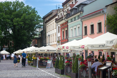 kazimierz: POLAND, KRAKOW - MAY 27, 2016: In the centre streets of the Kazimierz Jewish district of Krakow. For many centuries, Kazimierz was a place of coexistence and interpenetration of Christian and Jewish cultures. Editorial