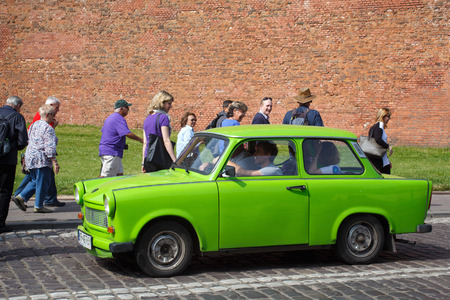 legendary: POLAND, KRAKOW - MAY 27, 2016: The legendary car brand Trabant on the streets of Krakow. The Trabant is an automobile that was produced from 1957 to 1990 by former East German (GDR). Editorial