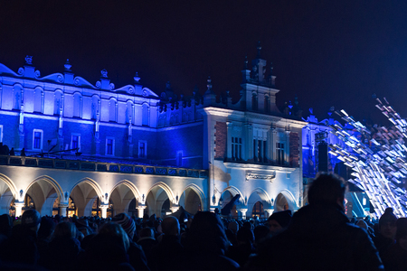 rynek: POLAND, KRAKOW - JANUARY 01, 2015: Celebrating the New Year 2015. Near famous Cloth Hall called Sukiennice at the Main Market Square in historical center of Krakow.