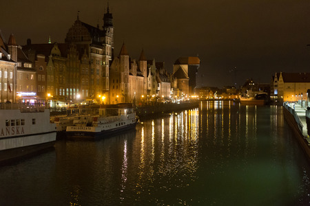 POLAND, GDANSK - DECEMBER 12, 2014: Panorama of historic part of town and the Motlawa River with its famous medieval Crane. Gdansk is a Polish city on the Baltic coast and popular center of tourism.