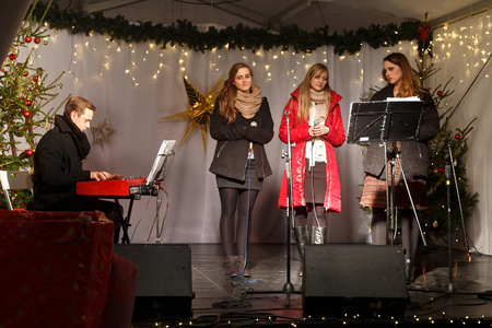 chorale: POLAND, SOPOT - DECEMBER 14, 2014: An unknown youth group performs catholic Christmas songs in anticipation of New Year holidays.