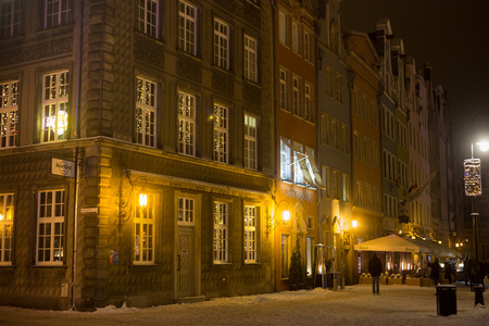 POLAND, GDANSK - DECEMBER 30, 2014: Historical buildings on the Long Market (Dlugi Targ) street at night. Gdansk is a Polish city on the Baltic coast and popular center of tourism. Editorial