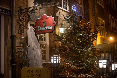 night before christmas: POLAND, GDANSK - DECEMBER 30, 2014: Night street of Gdansk in festive decoration before Christmas. Gdansk is a Polish city on the Baltic coast and popular center of tourism.